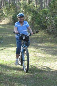 Peggy Biking Grassy Roads