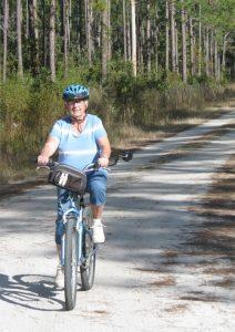 Peggy Biking down the Road
